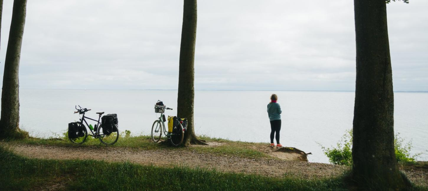 Woman enjoying the view in South Jutland during a pitstop along the N8 bike route